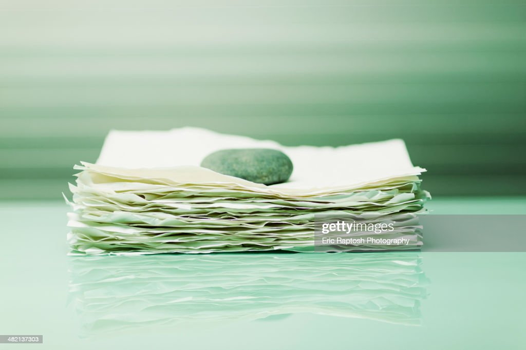 Stone on papers