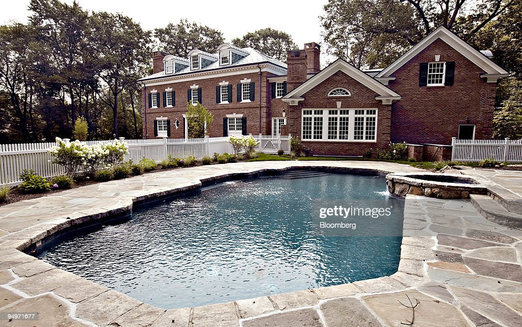 A Stone Patio Surrounds The Pool Outside A Spec Home At 38 French Road In  Greenwich