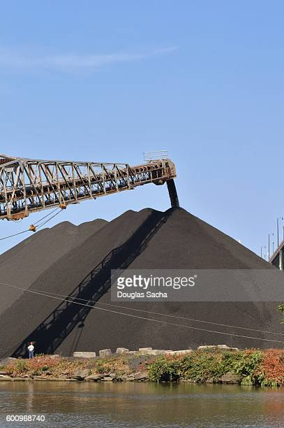 Stone Quarry with a Reaching conveyor arm loads mined material