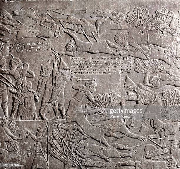 Stone relief from the palace Ashurbanipal The battle of Til Tuba with the Assyrians driving the Elamites into the River Ulai Assyrian Late Assyrian c...