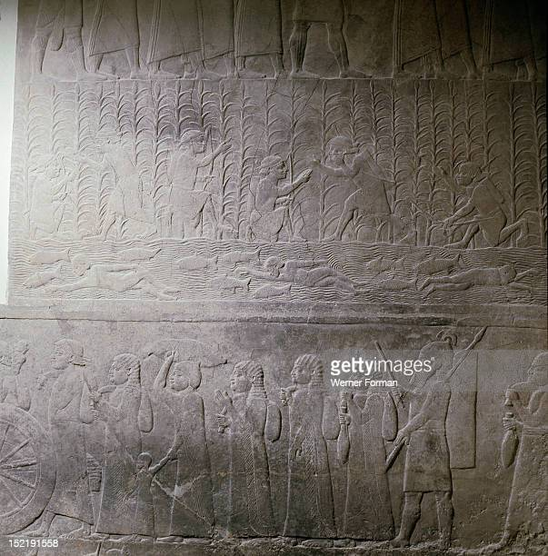 Stone relief from the palace of Ashurbanipal Elamite captives and spoil from the city of Hamanu and fugitives hiding in the marsh Assyrian Late...