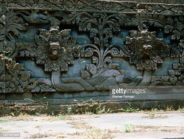 Stone relief on a temple wall at Sangsit Buleleng The world turtle BedawangNala is entwined by two cosmic serpents Indonesia Balinese 20th c Buleleng...