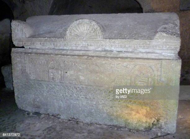 A stone sarcophagus with animal figures and geometric designs in Beth She'arim