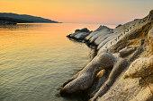 Stone sculpture mermaid at Portokali beach, Greece