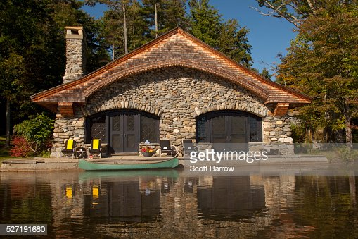 Stone summer home beside a lake : Stock-Foto