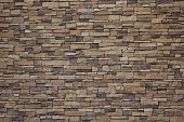 brown stone brick wall background.