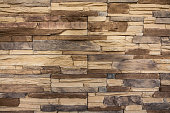 A stacked stone wall texture. Siding, building wall for backgrounds and textures.