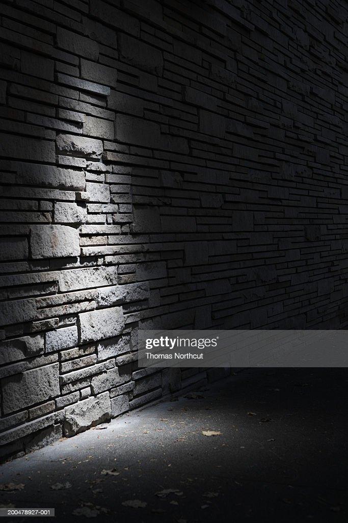 Stone wall illuminated at night : Stock Photo