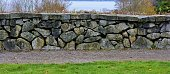 This stone wall is located in Discovery Park - Seattle, Washington.