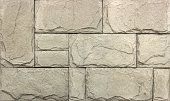 Stone wall texture,travertine tiles facing stone background