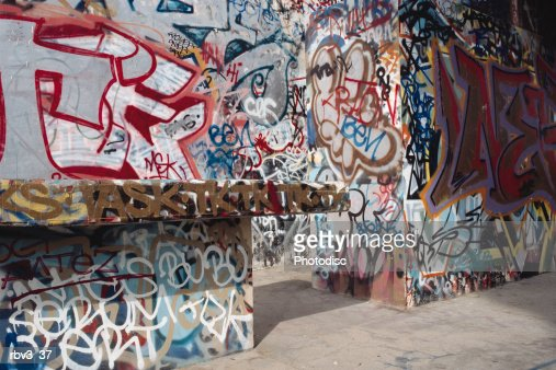 stone walls and ledges have been covered in painted graffiti