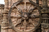 Intricate carvings on a stone wheel in the ancient  Hindu Sun Temple at Konark, Orissa, India.