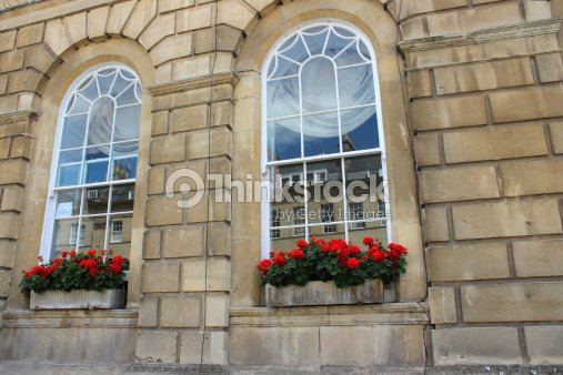 Stone Window Boxes With Red Flowers Bathstone House Stock Photo