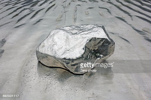 Stone with metal