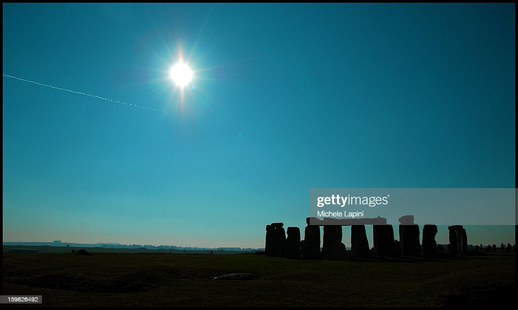 CONTENT] Stonehenge landscape at sunset.