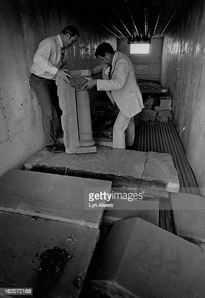 MAY 12 1984 MAY 13 1984 Stones from the ghost Building in a semitruck Sandy Brown Jim Brown lift up one of the heavy stones that made up the face of...