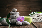 Stones hot stone, Orchid, bamboo and candle. Zen relaxation