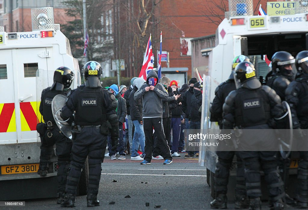 Stones litter the floor as police in riot gear and armoured vehicles clash with Union Flag waving loyalist protesters in east Belfast, Northern Ireland on January 12, 2013 after the latest loyalist march against the decision to limit the days on which the Union Flag would be flown over Belfast City Hall. Northern Irish demonstrators loyal to Britain clashed with nationalists and police on Saturday in fresh protests against curbs on flying the British flag, leaving four officers injured, police said. The clashes were the latest to blight the British province after more than five weeks of violent disorder over the flag issue.