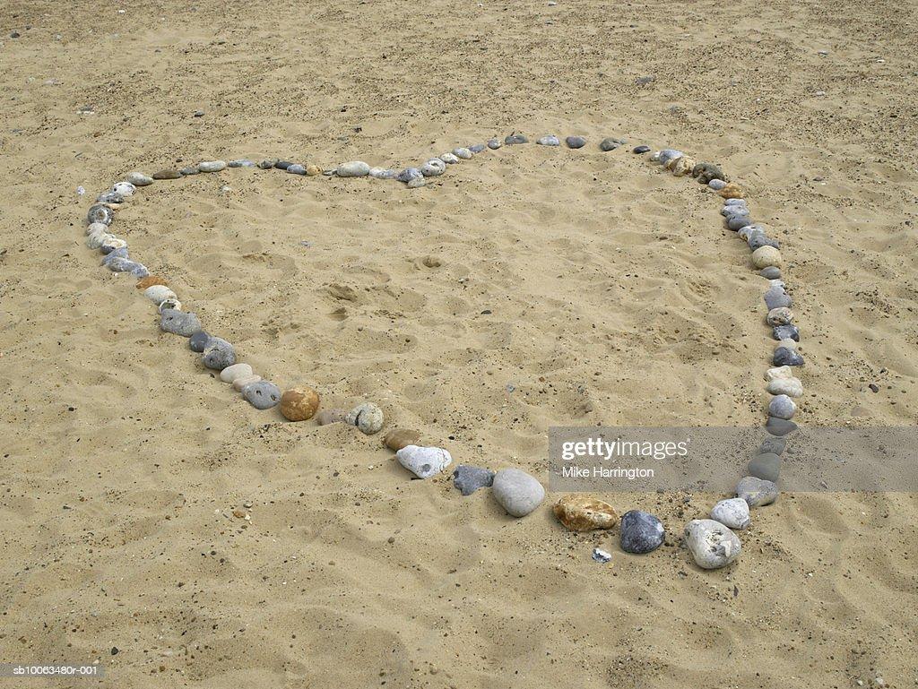 Stones on beach arranged to form heart shape : Stock Photo