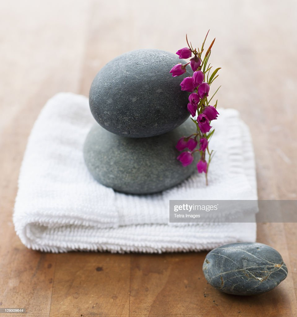 Stones on towel at spa : Stock Photo