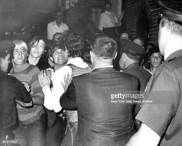 Stonewall Inn nightclub raid Crowd attempts to impede police arrests outside the Stonewall Inn on Christopher Street in Greenwich Village