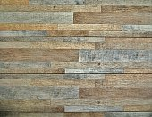 Stoneware wall cladding for interiors with wooden strips effect .