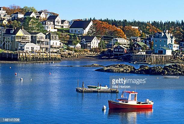 Stonington Harbor a typical New England fishing village with a lobster boat in the foreground Coastal Maine USA