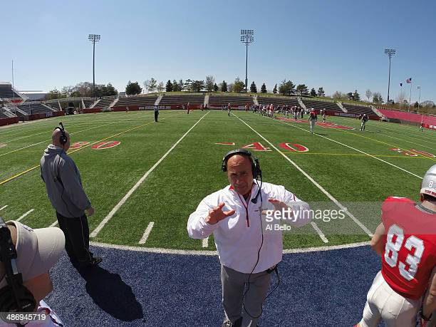 Stony Brook Head football Coach Chuck Priore speaks to Quarterback Conor Bednarski during their Spring Football Game at Kenneth P LaValle Stadium on...