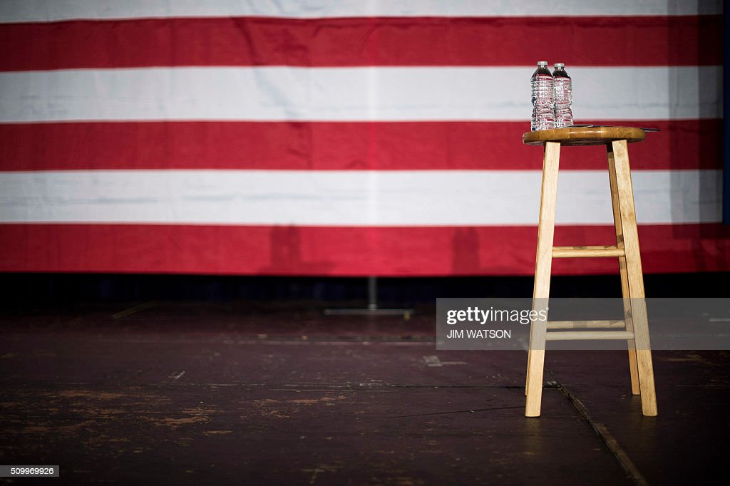 A stool and water wait on stage for Republican presidential candidate Jeb Bush at a town hall in Fountain Inn, South Carolina, on February 13, 2016. / AFP / JIM WATSON