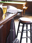 Stool by pint of beer on bar