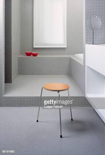 A stool in a modern bathroom