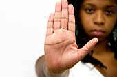 Stop Gesture Of African American Woman. She showa her Hand as a stop Sign with a Serious Facial Expresion on Background