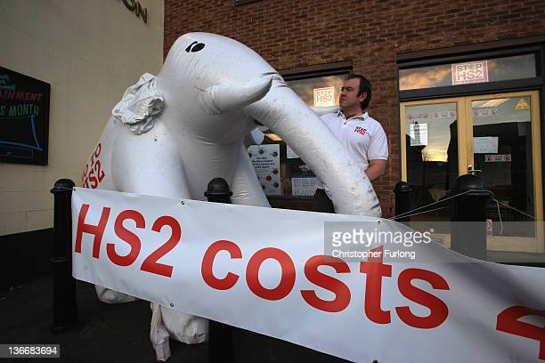 Stop HS2 Campaign coordinator Joe Rukin inflates a giant white elephant outside the campaign headquarters on January 10 2012 in Kenilworth United...