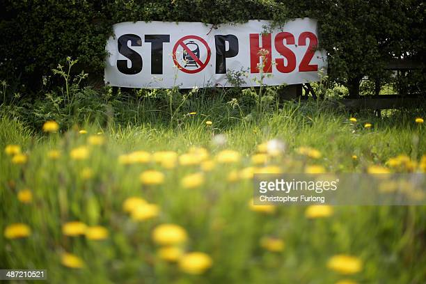 Stop HS2 posters mark the point where the proposed route of the new HS2 high speed rail link will pass through near to the village of Warburton on...