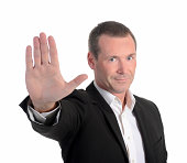 businessman showing stop with one hand