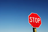 Stop sign against clear sky