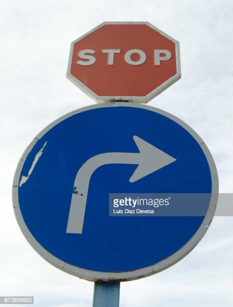 stop sign and right turn sign