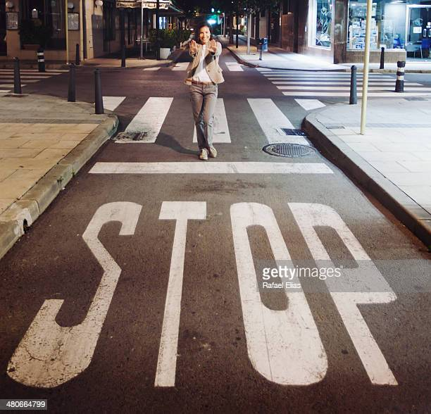 Stop sign and woman behind