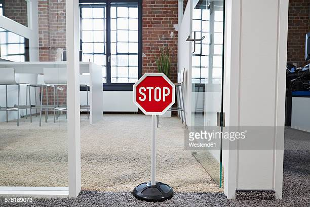 Stop sign in modern open plan office