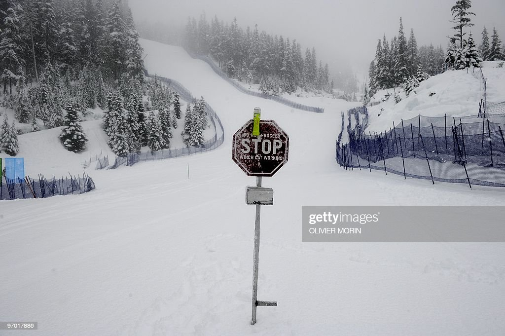 A stop sign is seen on the slope as the Alpine skiing competitions are postponed due to weather conditions at the Whistler Creekside Alpine skiing...