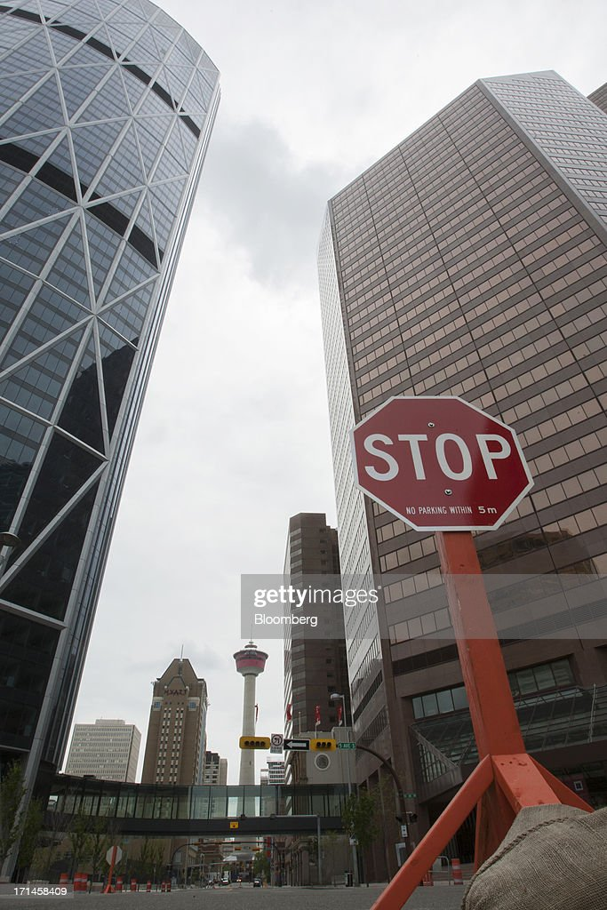 A 'Stop' sign marks the closed-off area in front of The Bow building, left, and Suncor Energy Centre, right, in the downtown core after flooding in Calgary, Alberta, Canada, on Monday, June 24, 2013. Water levels in Calgary subsided and crews are working to restore power as officials confirmed a fourth fatality in the worst flood in Alberta's history. Photographer: Keith Morison/Bloomberg via Getty Images