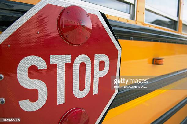Stop sign on side of school bus