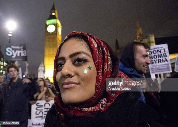 'Stop the War' activists stage a demonstration at Parliament Square central London United Kingdom on December 2 ahead of the House of Commons vote on...