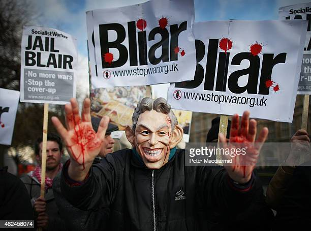 Stop the War Coalition protester wearing a mask depicting Former Prime Minister Tony Blair shows bloodied hands near Parliament on January 29 2015 in...