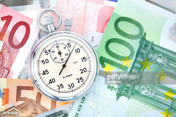 stop watch on euro bank notes