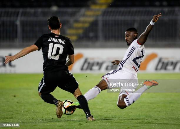 Stopira of Videoton in action against Marko Jankovic of Partizan during the UEFA Europa League Qualifying PlayOffs round first leg match between...