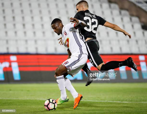 Stopira of Videoton is challenged by Uros Djurdjevic of Partizan during the UEFA Europa League Qualifying PlayOffs round first leg match between...