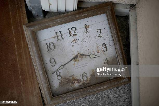 A stopped clock covered in five years of dust sits in tsunami damaged home inside the exclusion zone close to the devastated Fukushima nuclear plant...