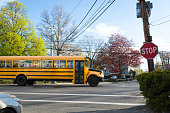Stopped sign and School Bus at intersection
