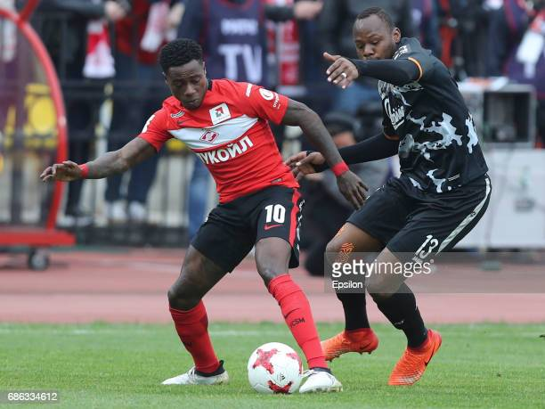 Stoppila Sunzu of FC Arsenal Tula is challenged by Quincy Promes of FC Spartak Moscow during the Russian Premier League match between FC Arsenal Tula...